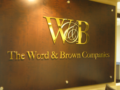 Word & Brown Lobby Sign by Landmark Signs
